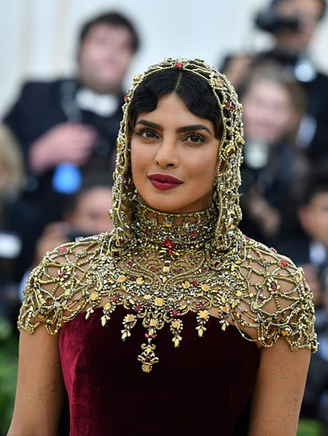 "Priyanka Chopra had on delicate Cartier rings with her custom ""bejeweled"" Ralph Lauren gown."