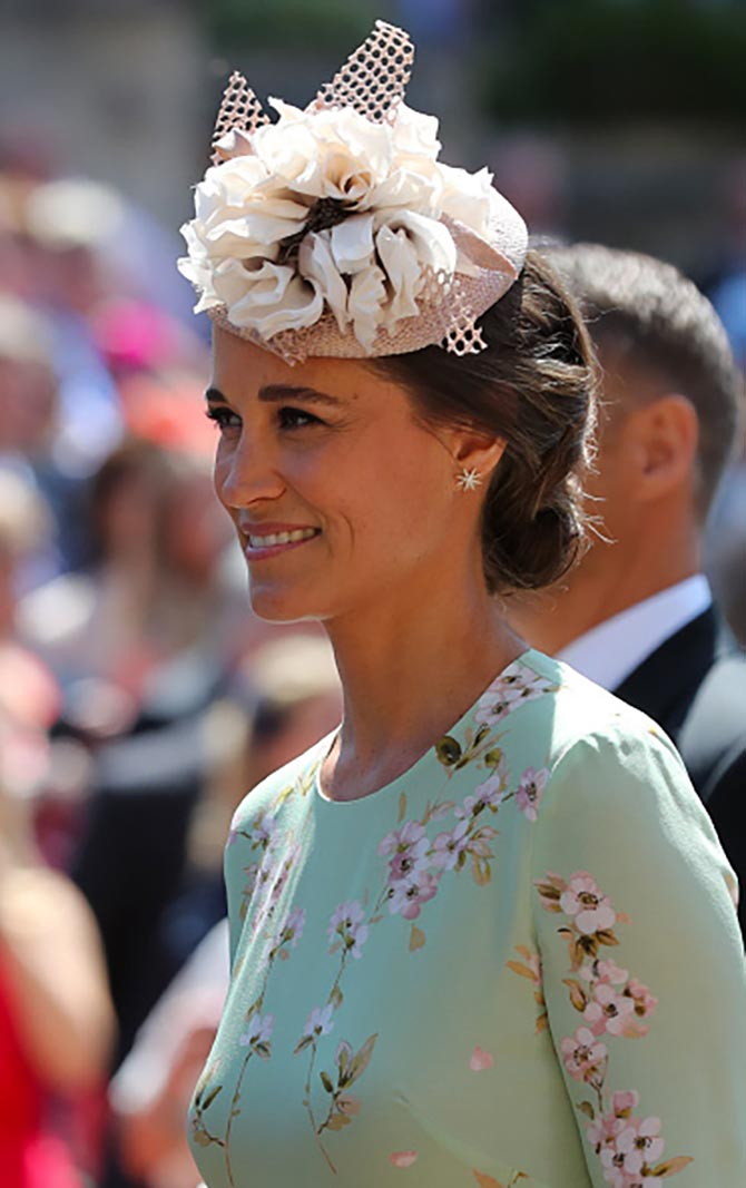 Pippa Middleton in a floral dress, hat and gold and diamond earrings.