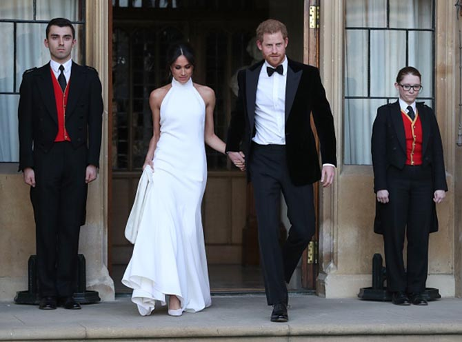 The newly married Prince Harry, Duke of Sussex and Meghan Markle, Duchess of Sussex leaving Windsor Castle in Windsor for an evening reception. Photo Getty Images