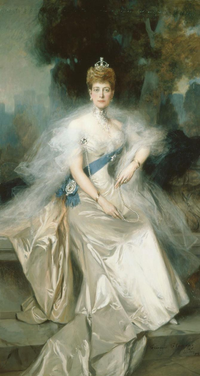 A 1908 portrait of Queen Alexandra by the French artist François Flameng, she is wearing the riband and star of the Order of the Garter, her collier résille necklace, made by Cartier in 1904, and the Koh-i-nor in a brooch setting. Photo ©Royal Collection
