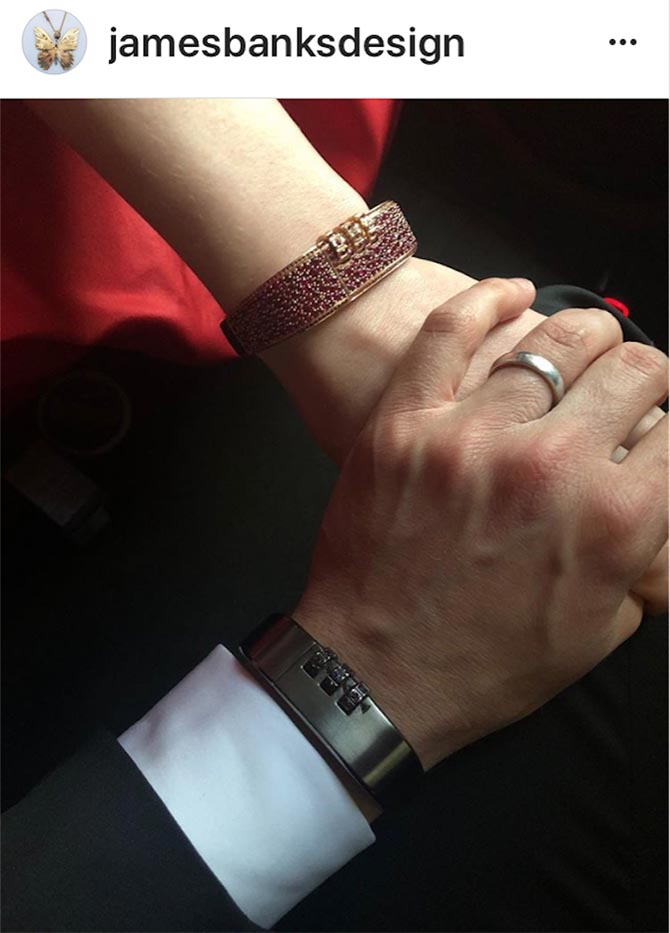 A detail shot of Anne Hathaway and her husband Adam Shulman's hands show their bracelets from the James Banks collection he co-designs with Heidi Nahser Fink