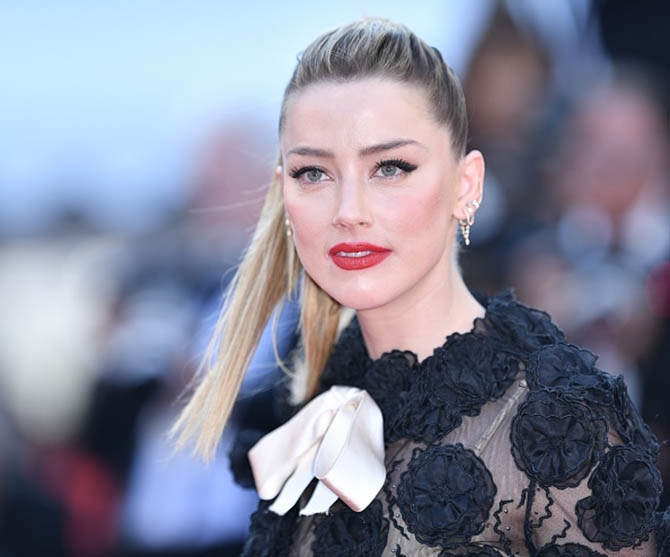 Amber Heard in a Giambattista Valli dress and diamond earrings all from Anita Ko.
