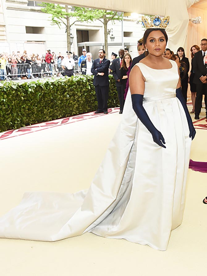 Mindy Kaling dressed like a princess in a Vassilis Zoulias dress, a Pericles Kondylatos crown and Fred Leighton earrings.