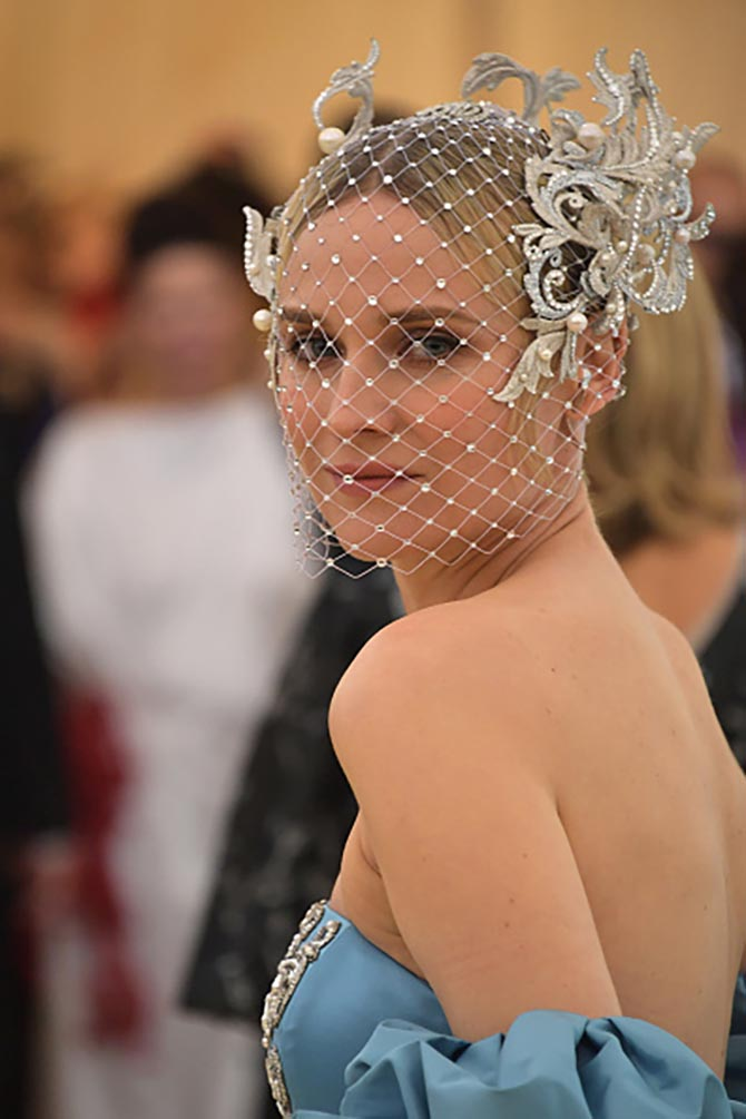 Diane Kruger wore a dramatic head piece by Philip Treacy with Tasaki jewelry and a custom Prabal Gurung gown.