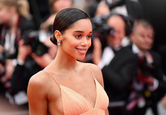 Laura Harrier in a Louis Vuitton dress and Bulgari earrings.