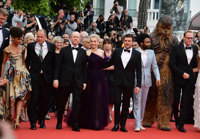 "oonas Suotamo, Woody Harrelson, Ron Howard, Emilia Clarke, Alden Ehrenreich, Donald Glover, Chewbacca and Paul Bettany attend the screening of ""Solo: A Star Wars Story"" during the 71st annual Cannes Film Festival at Palais des Festivals on May 15, 2018 in Cannes, France. (Photo by George Pimentel/WireImage)"