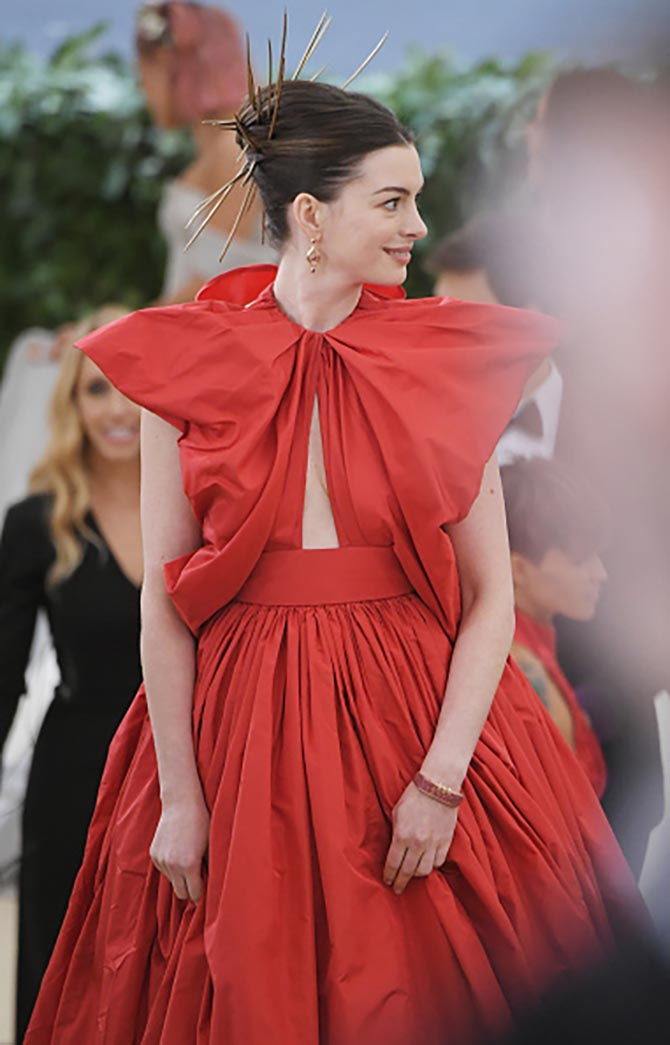 Anne Hathaway wore James Banks earrings and The Code ruby bracelet with a custom Valentino gown.