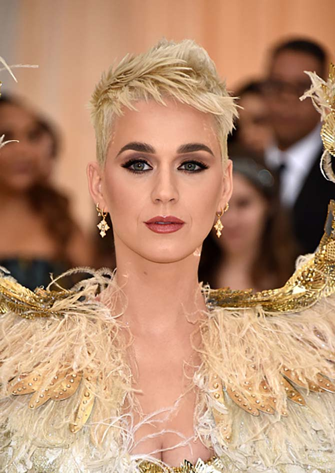 Katy Perry wore delicate earrings with her 6 foot high wings and Versace dress.