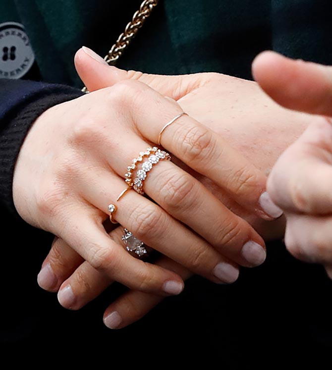 Detail of Meghan Markle's hands shows several of her favorite rings. Photo Getty