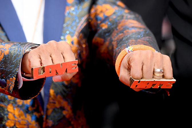 Spike Lee wearing Love and Hate rings