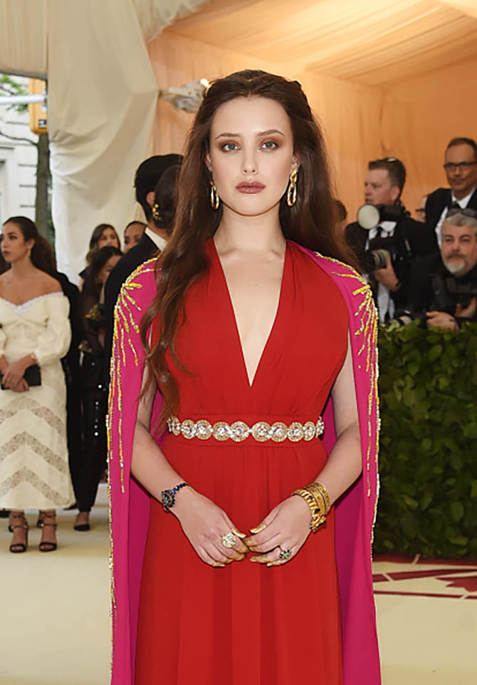 Katherine Langford put on vintage jewels including pieces from Fred Leighton with her red Prada gown.