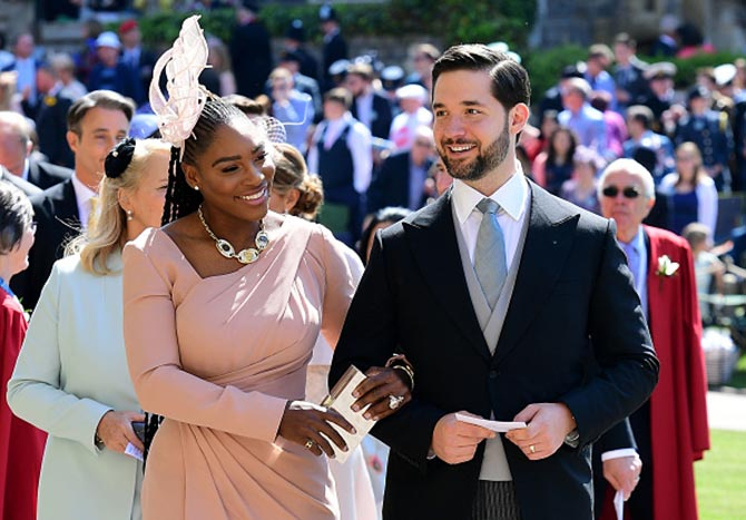 Alexis Ohanian with Serena Williams who is wearing a Bulgari Monete diamond and gold necklace with an Audemars Piguet watch and a Versace dress.