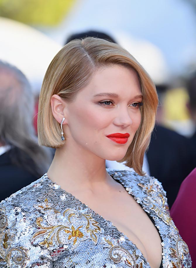 Léa Seydoux in Boucheron blue and white diamond earrings.