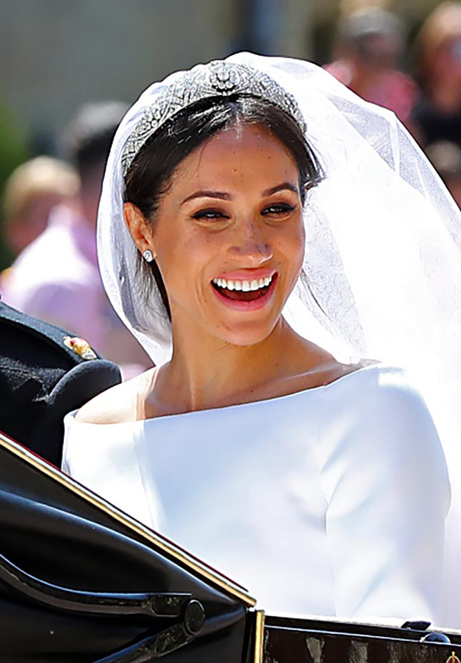 Meghan, Duchess of Sussex, wearing Queen Mary's diamond and platinum bandeau and Cartier earrings Photo Getty Images