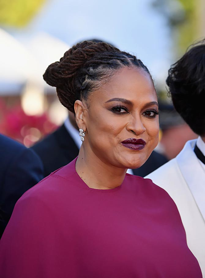 Ava DuVernay in Chopard diamond earrings.