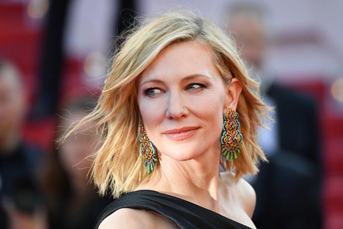 Cate Blanchett in Chopard earrings and a Giorgio Armani Privé gown.