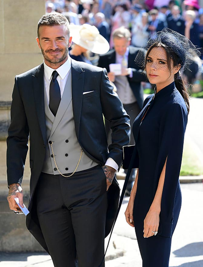David Beckham with Victoria Beckham with is wearing one of her own dress designs and her diamond engagement ring.