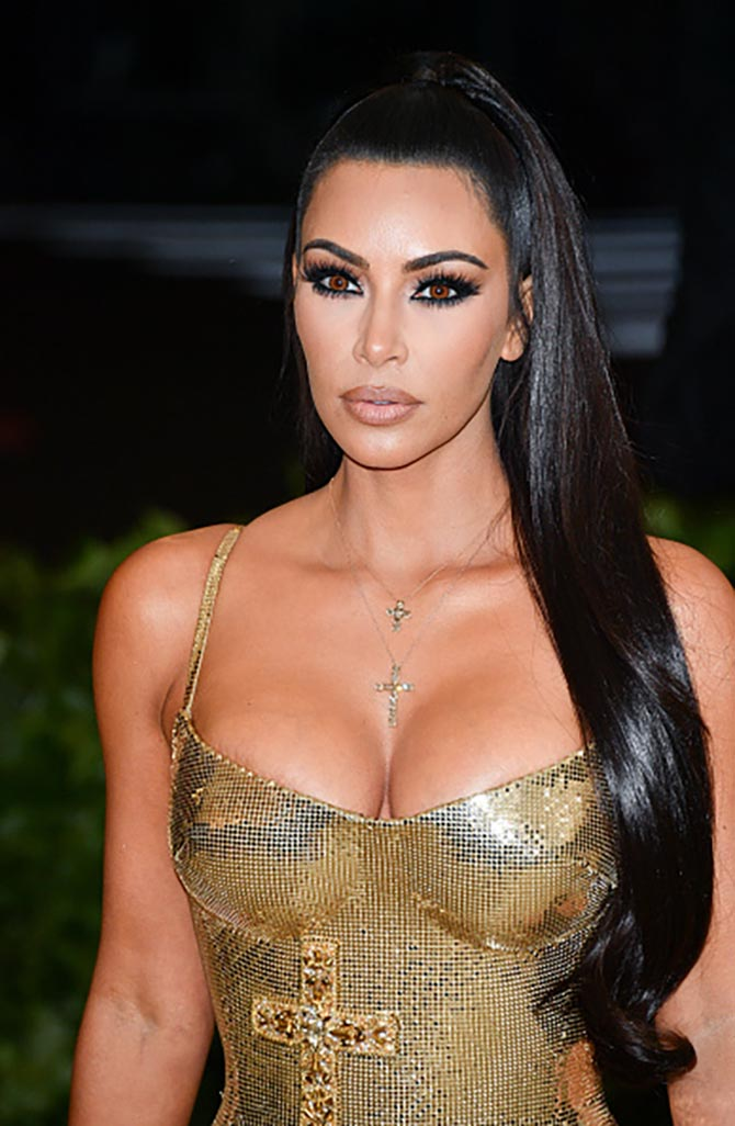 Kim Kardashian layered crossed from Lorraine Schwartz with her Versace dress.
