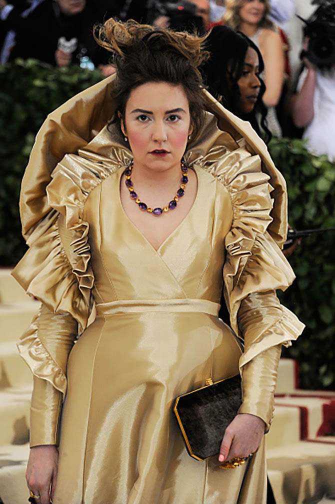 Lena Dunham paired a Stephen Webster necklace with a gold gown from Ronald van der Kemp.