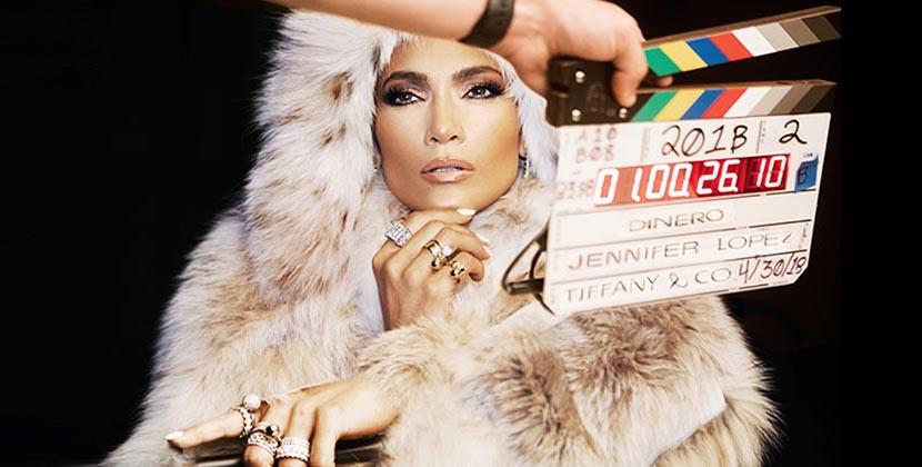 "The AdventurinePostsJ.Lo Wears Jewelry Worth Millions in ""Dinero"""