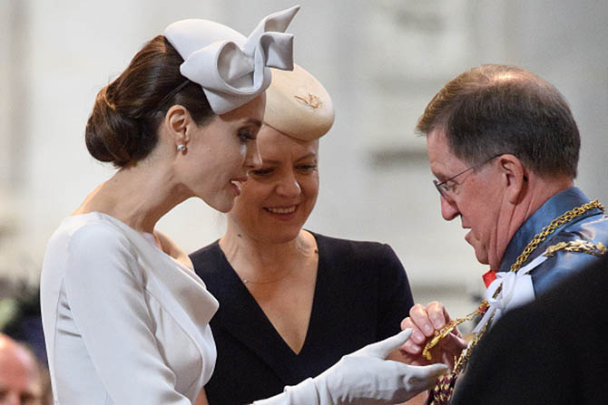 Angelina Jolie reviewing what appears to be a Star Badge of a Knight Commander at the 200th anniversary of the Most Distinguished Order of St Michael and St George at St Paul's Cathedral on June 28, 2018 in London, England. Photo Getty Images