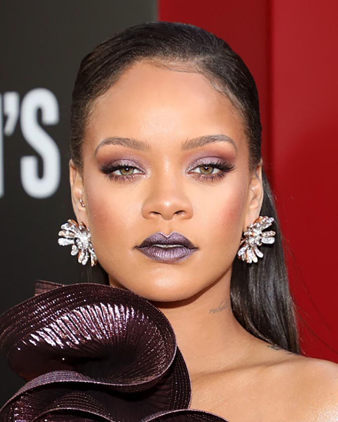 Rihanna's Bulgari floral diamond, white and pink gold earrings picked up on the metallic shine of her Givenchy dress.