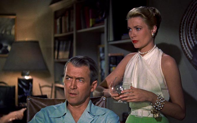 James Stewart and Grace Kelly wearing pearl earrings, a choker and the famous pearl charm bracelet in 'Rear Window.'