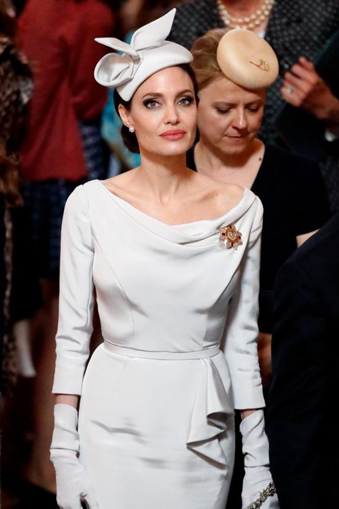 Angelina Jolie in London wearing the Order of St. George and St. Michael pin.