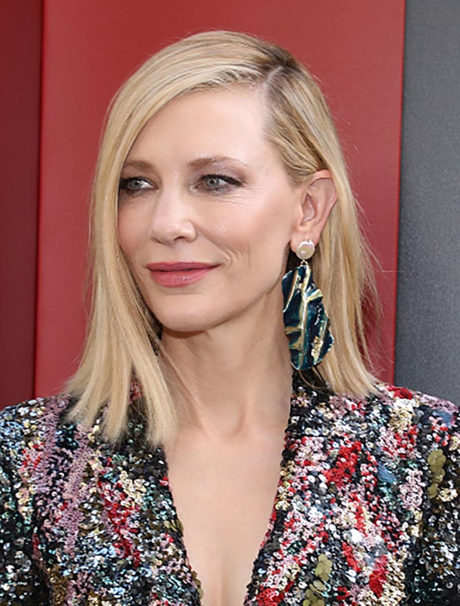 Cate Blanchett paired a Missoni pantsuit with costume earrings by Rachel Comey.