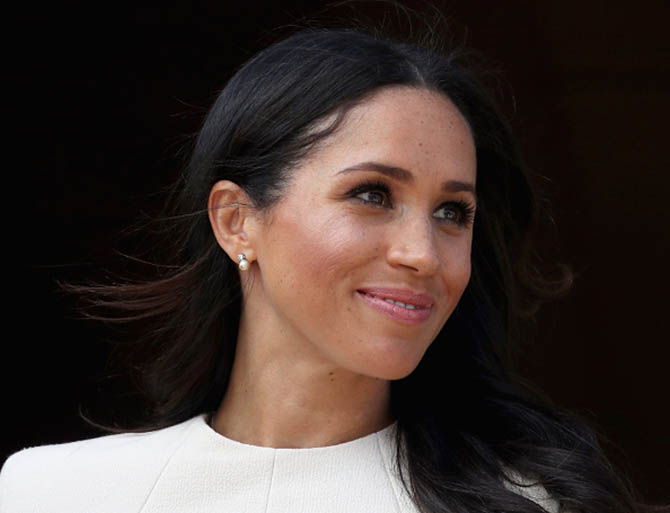 Meghan, the Duchess of Sussex wearing pearl and diamond earrings she received from the Queen.