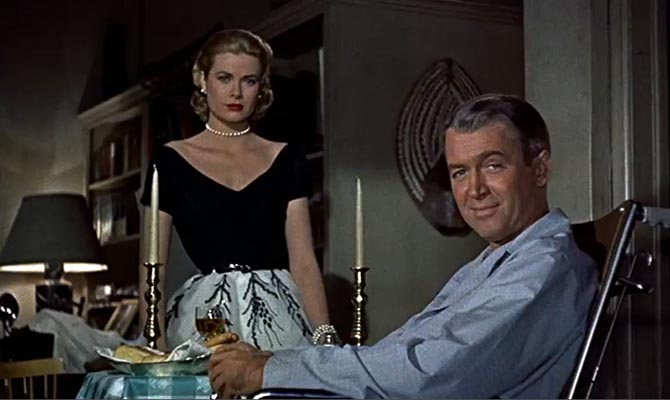 James Stewart and Grace Kelly wearing a pearl choker and bracelet in 'Rear Window.' Photo