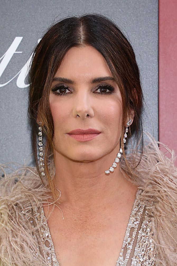Sandra Bullock sported diamond shoulder dusters by Lorraine Schwartz with an Elie Saab gown.