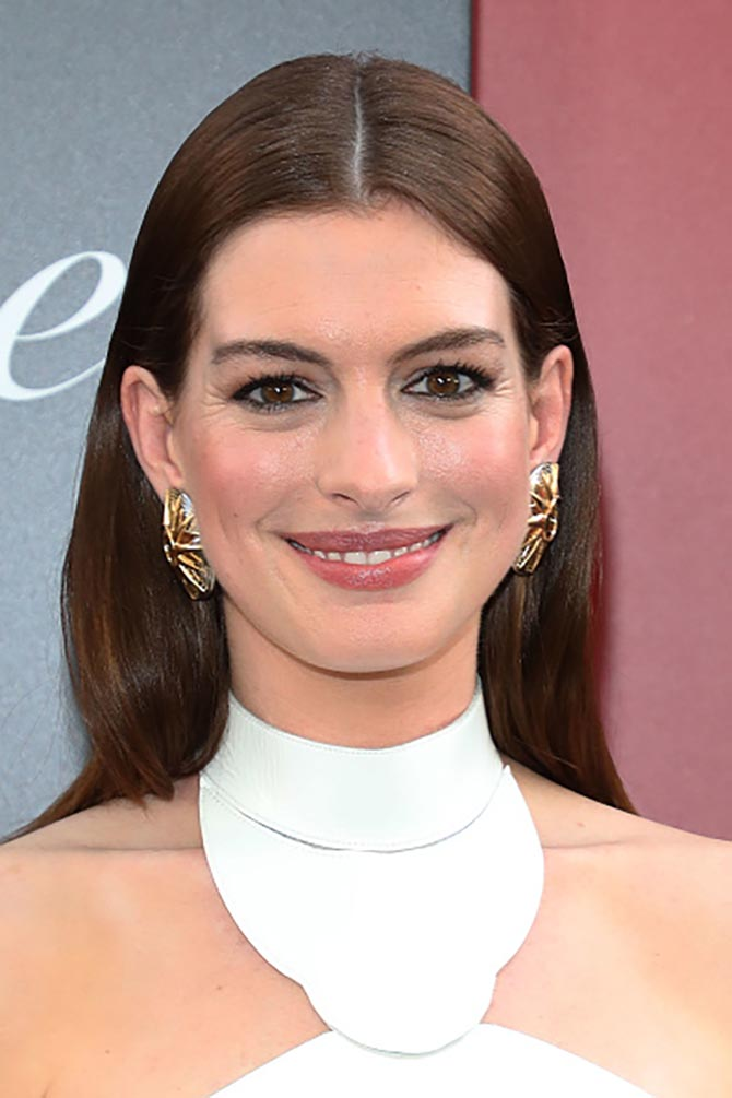 Anne Hathaway put on a vintage pair of Cartier earrings with a Jean Paul Gaultier gown.
