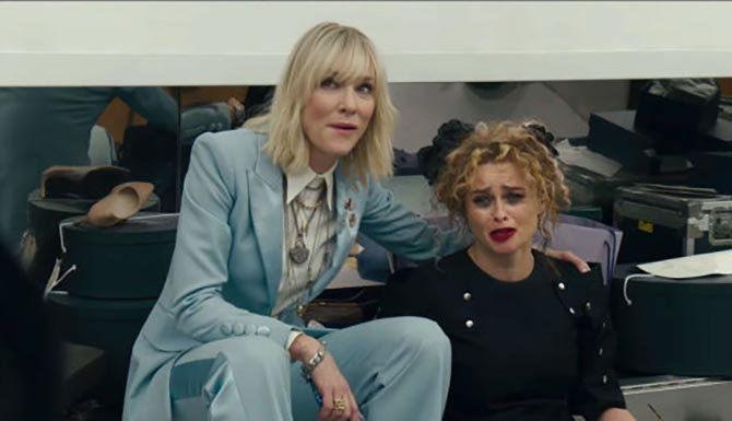 Cate Blanchett wearing a Sevan Biçakçi padlock necklace among other jewels while she comforts Helena Bonham Carter in 'Ocean's 8.' Photo via