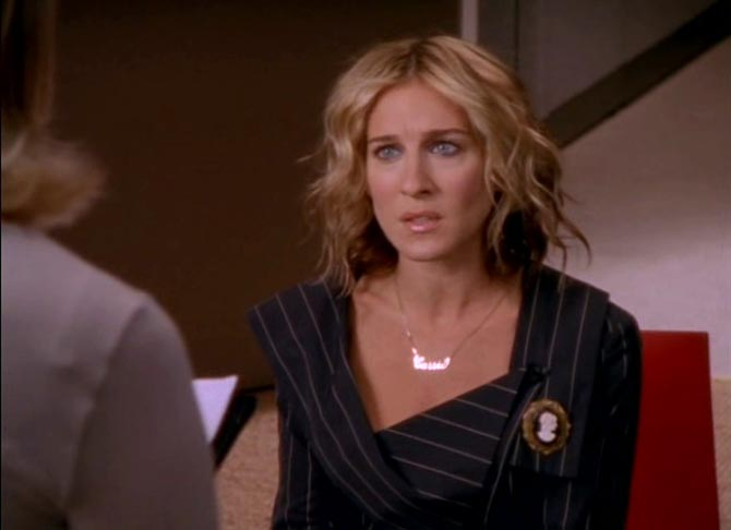 Sarah Jessica Parker had a meeting at Vogue wearing her Carrie necklace and a cameo pin. Photo