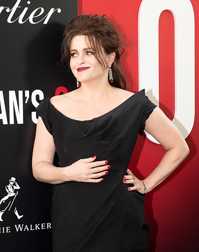 Helena Bonham Carter wore Cartier earrings with a black Vivienne Westwood gown.