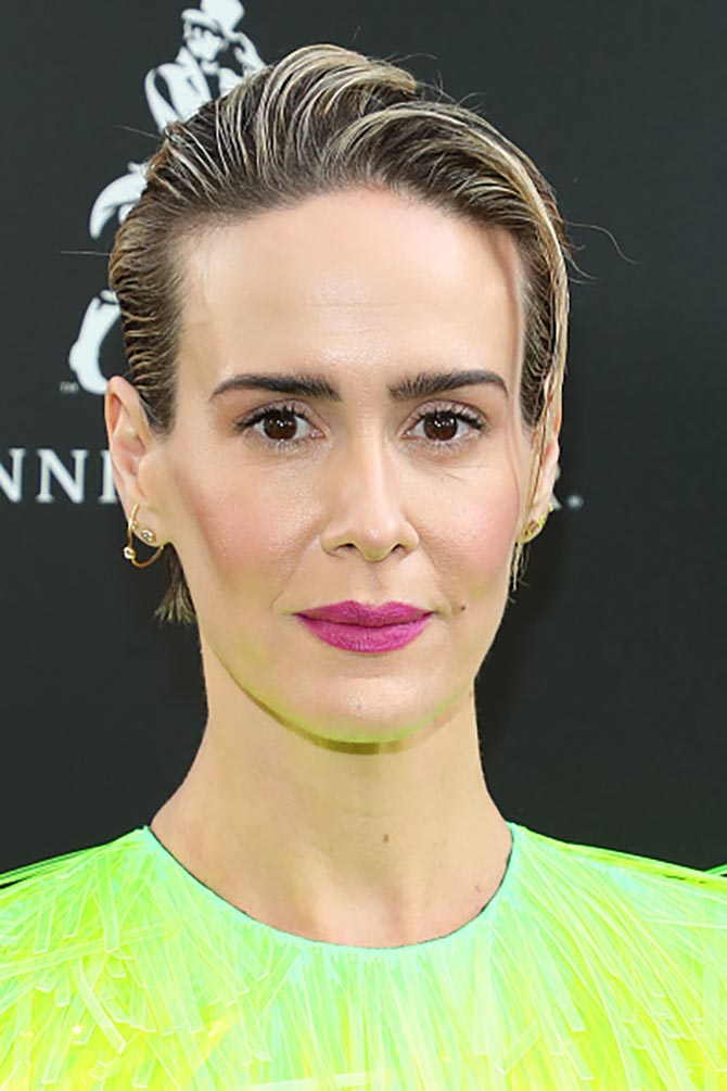 Sarah Paulson paired her Prada gown with earrings layered in lobes including the Christy diamond and gold earring from Ana Khouri.