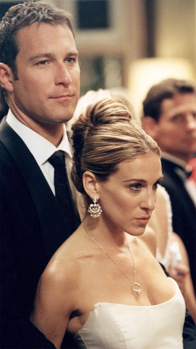 Jon Corbett with Sarah Jessica Parker who is wearing Fred Leighton Chandelier Earrings and Asscher Cut Diamond Engagement ring on a chain necklace