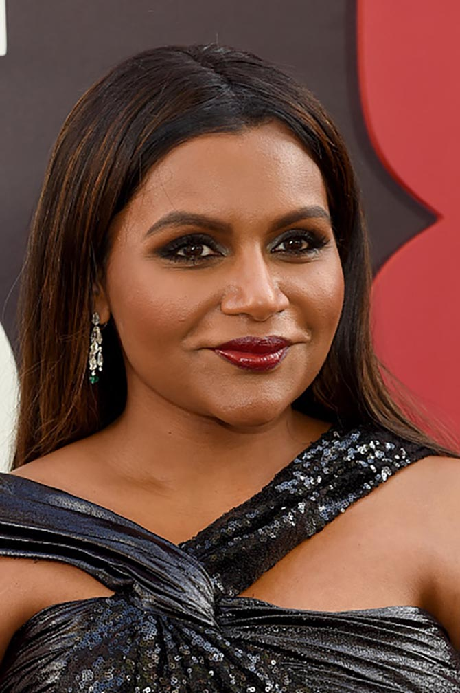 Mindy Kaling sparkled in Cartier earrings and a black sequin gown by Prabal Gurung.