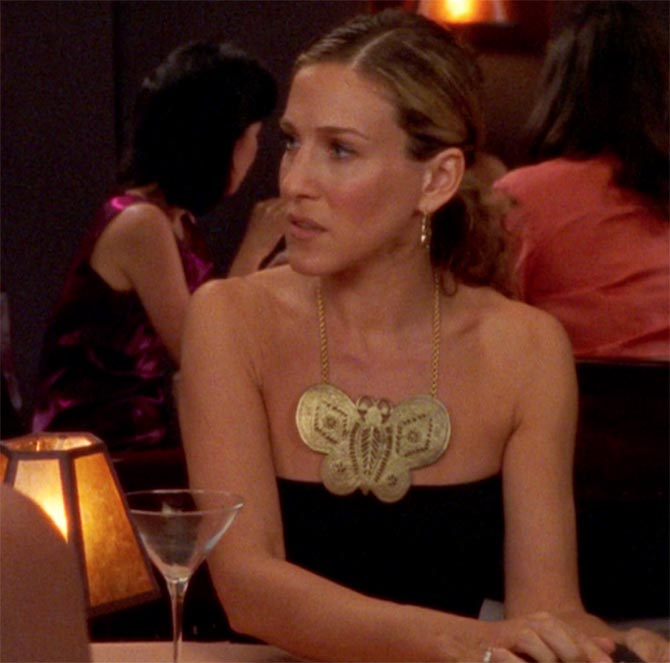Sarah Jessica Parker wearing the Kenneth Jay Lane Butterfly Necklace. Photo via @everyoutfitonsatc/Instagram