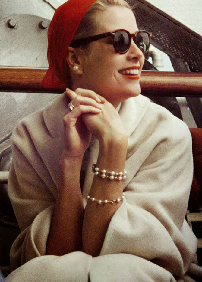 Grace Kelly wearing pearl earrings and a bracelet similar aboard the USS Constitution in 1956 en route to Monaco to marry Prince Rainier. Photo