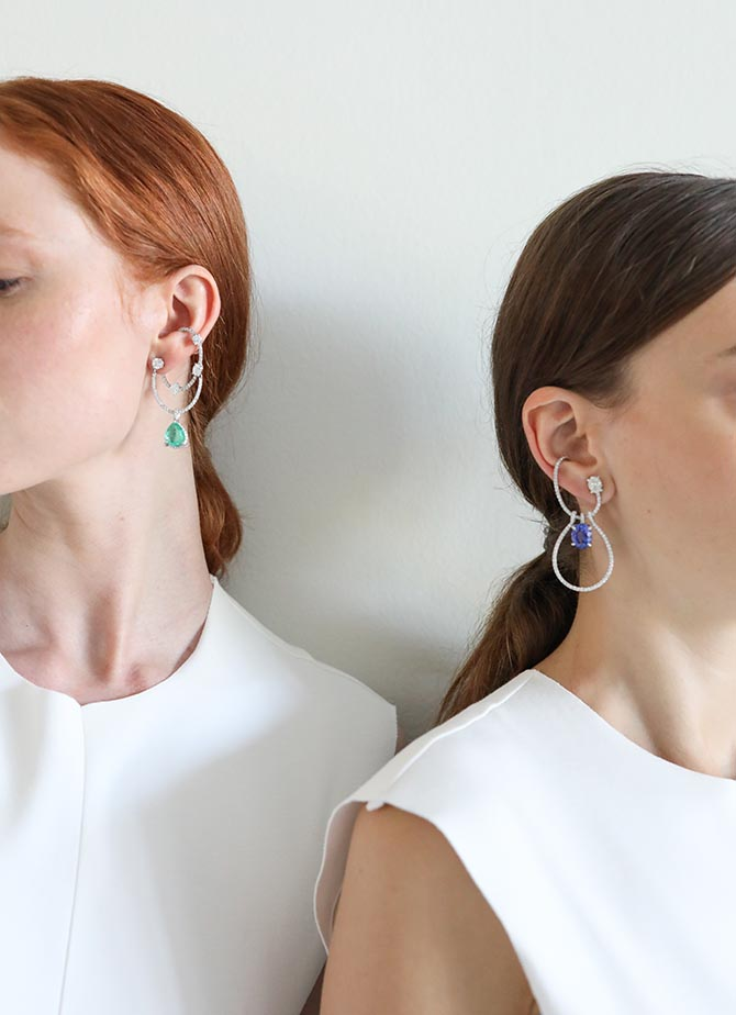 Two models wearing earrings by Ana Khouri at the designers High Jewelry presentation at Musée des Arts Décoratifs in Paris on July 3, 2018. Photo courtesy