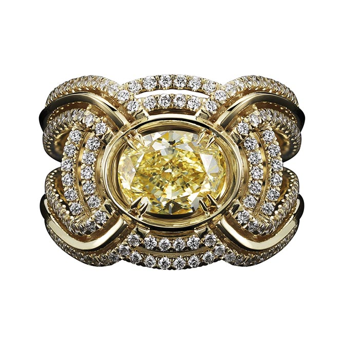 Alexandra Mor engagement ring with a 1.80-carat oval shape yellow diamond surrounded by swirls of diamond and yellow gold.