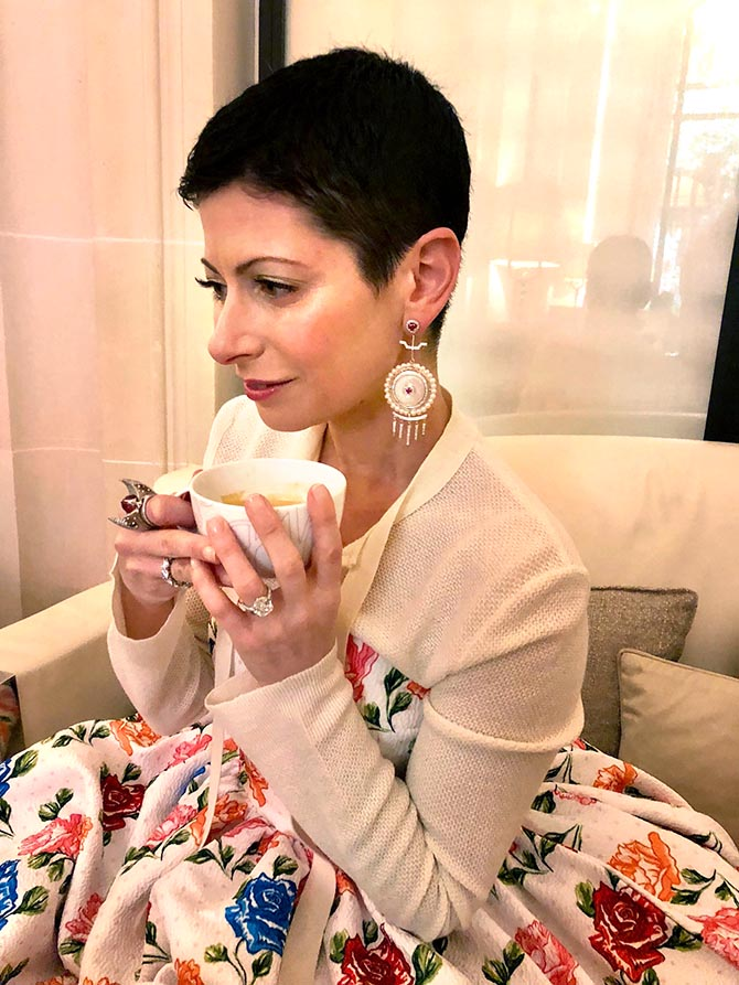 Lauren Kulchinsky Levinson enjoying tea in Paris wearing an Emilia Wickstead gown with Hanut Singh Earrings and her signature rings. Photo courtesy