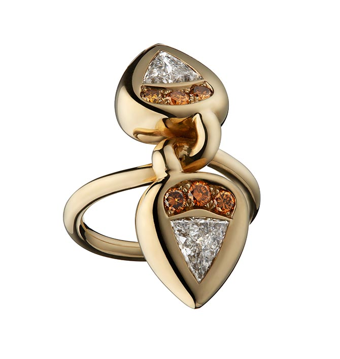 This 18K gold Double Snake Ring with 2 triangular diamonds and natural orange diamonds from Maison Auclert