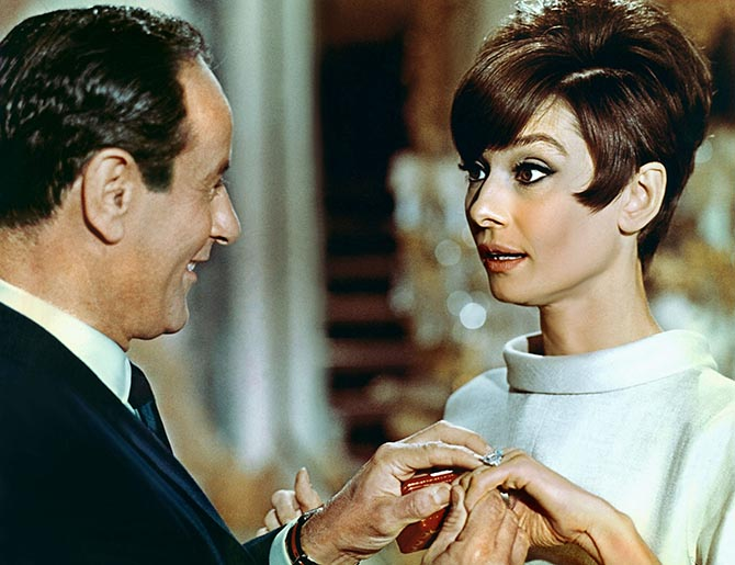 Eli Wallach proposing to Audrey Hepburn in 'How to Steal a Million' with a Cartier ring. Photo Alamy