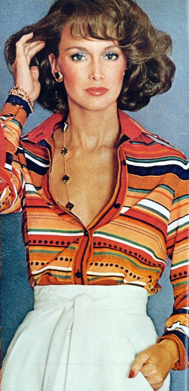 Seventies supermodel Karen Graham wearing a Van Cleef & Arpels Alhambra necklace in 1973. Photo via Pinterest