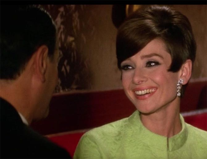 Audrey Hepburn in a Givenchy dress and Cartier diamond earrings in 'How to Steal a Million.' Photo