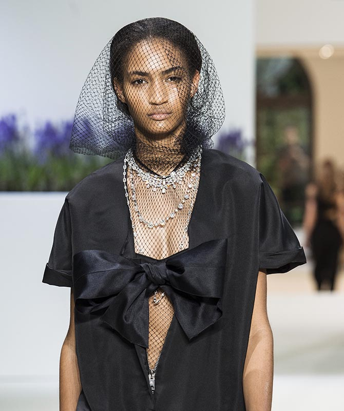 Model Anyelina Rosa wearing Giambattista Valli with three Chopard diamond necklaces. The choker length jewel is set with pear-shaped and marquise-cut diamonds and brilliants. The medium length necklace is set with 50-carats of round diamonds. The long necklace has 72-carats of Ashoka diamonds.
