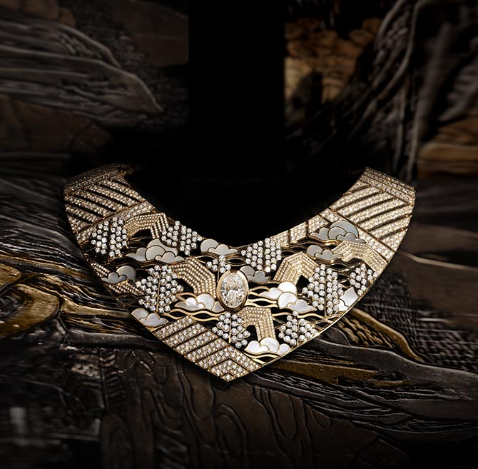 The Horizon Lointain necklace features motifs found on Chanel's Coromandel screens. The design is composed of platinum, yellow gold, diamonds and mother of pearl.